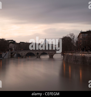 Time lapse view of bridge over river - Stock Photo