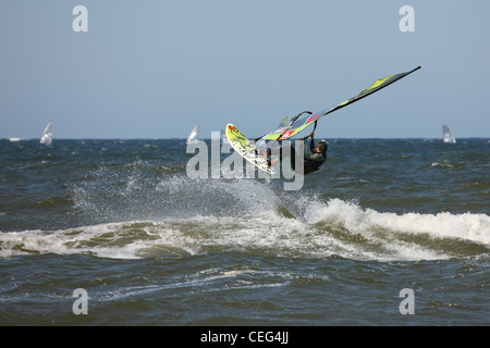 Surfer on the fly in the waters of the Baltic Sea. - Stock Photo
