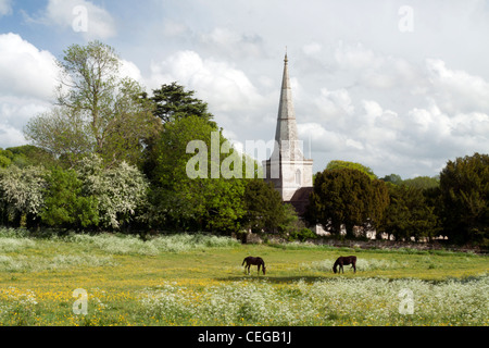 The spire of St. Margaret of Antioch Church at Chilmark in Wiltshire, England. - Stock Photo
