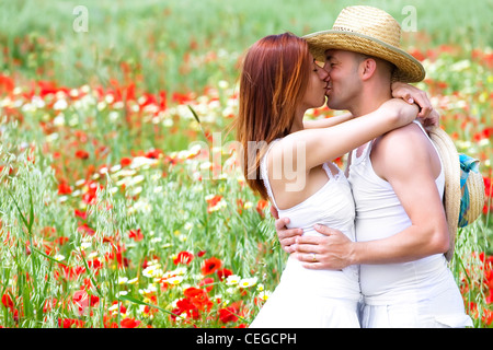 Young happy couple on a meadow - Stock Photo