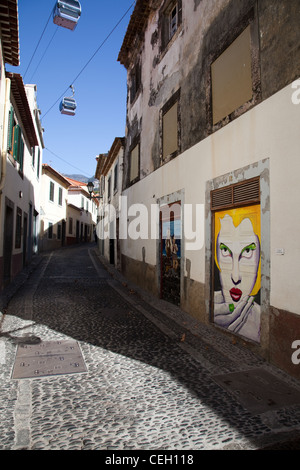 Cabel Cars above Rue Santa Maria_Zona Histroica do Funchal_Portas com Arte_Doors with Art in Funchal, Madeira, Portugal. - Stock Photo