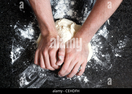 Hands kneading a dough - Stock Photo