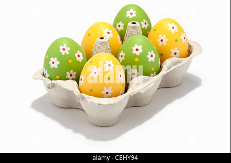 Decorated Easter eggs in an egg box - Stock Photo