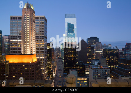 Buildings lit up at dusk downtown Manhattan looking north, New York City, New York State, USA - Stock Photo