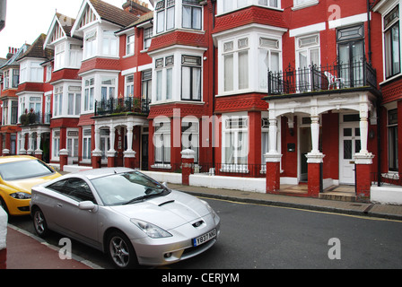 suburban street with terraced houses Eastbourne UK - Stock Photo