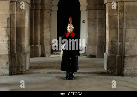 Changing the guard at Buckingham Palace. The household troops have guarded the sovereign and the royal palaces since - Stock Photo