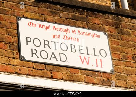 Portobello Road Street W11 Market London street sign brick wall by The Royal Borough of Kensington & Chelsea - Stock Photo