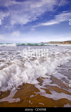 Waves rolling onto Newgale beach. - Stock Photo
