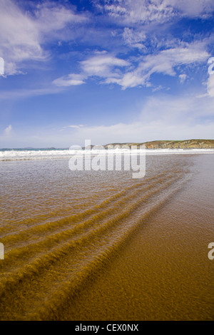Ripples in the shallow surf at Newgale beach. - Stock Photo