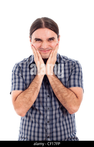 Portrait of happy young man grimace, isolated on white background. - Stock Photo