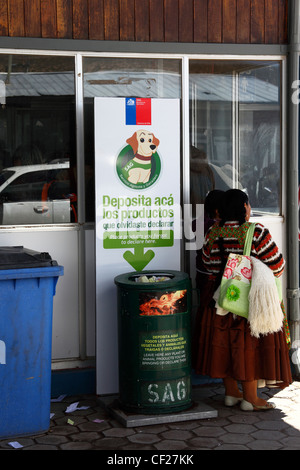 Bin at border control post for depositing all fresh produce not declared to customs for destruction , Bolivia / - Stock Photo