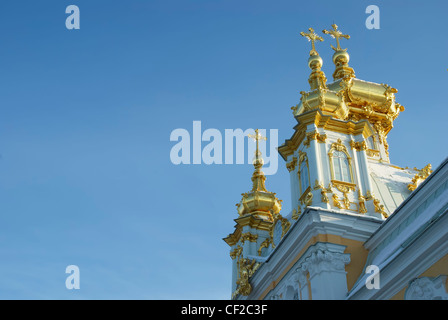 Gilded domes of orthodox church of palace complex in Petergofe on a background sky. - Stock Photo