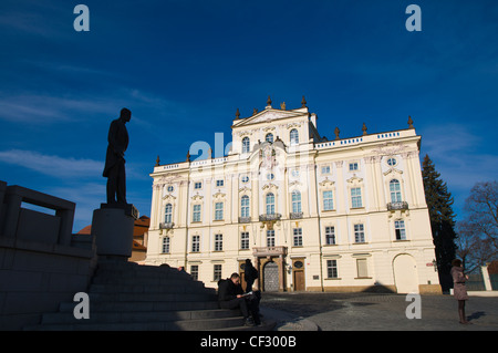 Archbishop's Palace exterior and Masaryk statue Hradcanske namesti square Hradcany the castle district Prague - Stock Photo