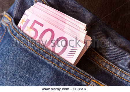 Banknotes cash money 500 Euro Euros Eur thousands blue denim levi 501 jeans pocket - Stock Photo