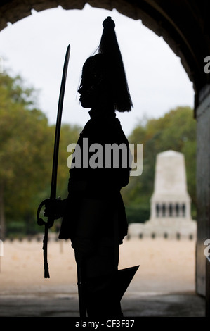 Silhouette of a soldier of the Household Cavalry on guard duty at Horse Guards in Whitehall. - Stock Photo