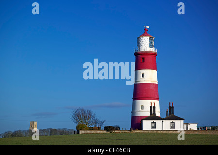A view toward Happisburgh Lighthouse. It is the oldest working light in East Anglia and the only independently run - Stock Photo