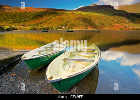 Fishing boats on Tal Y Llyn lake in Snowdonia. - Stock Photo