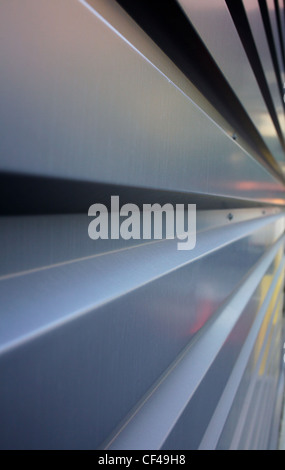Rectangular corrugation of a steel or aluminium wall in diminishing perspective to the right - Stock Photo