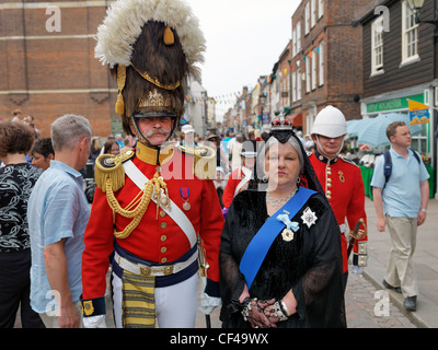Queen Victoria Character and military man at the Dickens Festival of 2010. - Stock Photo
