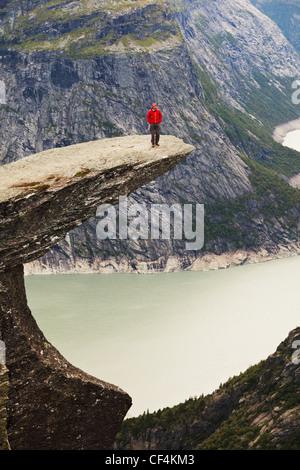 hike in Norway mountains,Trolltunga cliff near Odda - Stock Photo