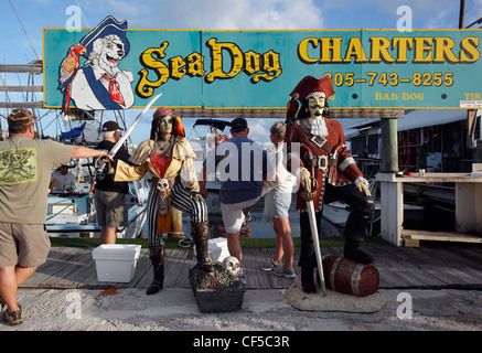 Mannequins in front of a charter fishing operation, Marathon Key, Florida - Stock Photo