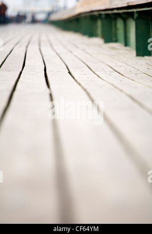 Long view along the plank decking of Clevedon Pier, the only fully intact, Grade 1 listed pier in the country. - Stock Photo