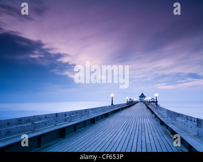 Twilight view along the boardwalk towards the end of Clevedon Pier, the only fully intact, Grade 1 listed pier in - Stock Photo