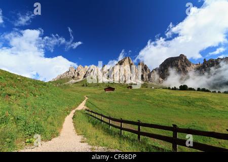 pathway in Gardena pass beneath Cir Dolomites mountain - Stock Photo