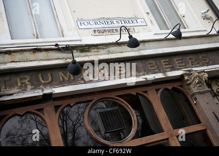 Signage of a typical old east end public house in Fournier Street. - Stock Photo