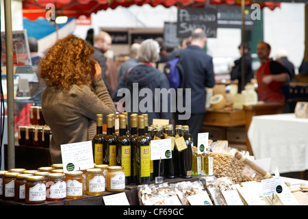 An interior view of stalls and customers at Borough Market. - Stock Photo