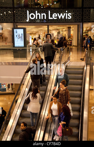 People going up the escalator to the John Lewis store, Westfield Shopping centre, Stratford London UK - Stock Photo