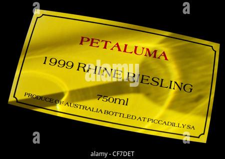 1999 Petaluma Riesling wine bottle label with shadow of wine tasting glass Clare Valley, South Australia, Australia - Stock Photo