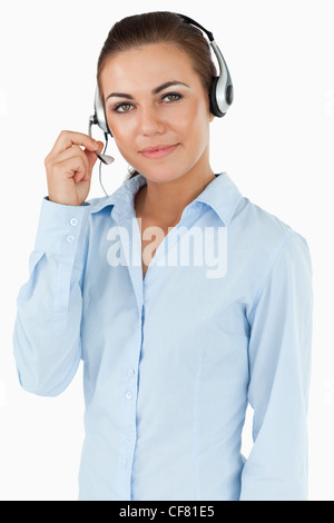 Young female call center agent - Stock Photo