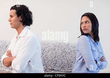 Couple having an argument in the living room - Stock Photo