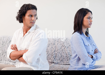 Couple having a fight in the living room - Stock Photo