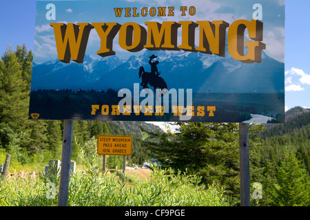 Welcome to Wyoming road sign at the Idaho, Wyoming state border, USA. - Stock Photo