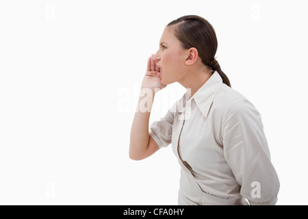 Side view of a businesswoman shouting - Stock Photo