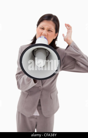 Angry businesswoman shouting through businesswoman - Stock Photo
