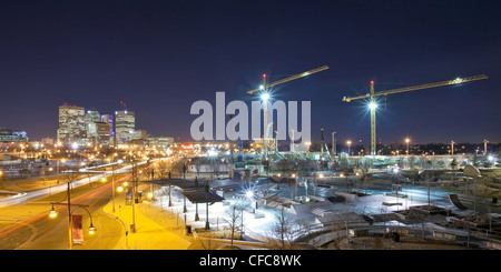 Canadian Museum for Human Rights construction site, The Forks Skateboard Park and city skyline. Winnipeg, Manitoba, - Stock Photo