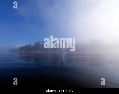 Misty scenery with tower of Frauenwoerth monastery in the background, Frauenchiemsee, Fraueninsel, Chiemgau, Bavaria, - Stock Photo