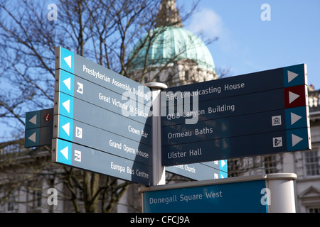 tourist directions and information signs donegall square in front of Belfast City Hall Northern Ireland UK - Stock Photo