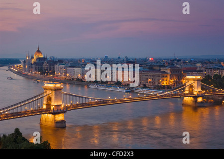 Panorama of the Hungarian Parliament, and the Chain bridge (Szechenyi Lanchid), over the River Danube, Budapest, - Stock Photo
