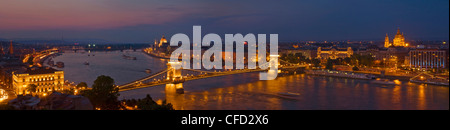 Panorama of the Hungarian Parliament and the Chain bridge (Szechenyi Lanchid) over the River Danube, Budapest, Hungary - Stock Photo