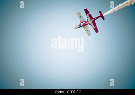 Two planes fly top to top during the snowbirds aerial performance in Comox, Vancouver Island, British Columbia, - Stock Photo