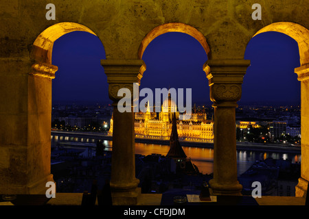 View from the Fisherman's Bastion onto the House of Parliament at Danube river at night, Budapest, Hungary, Europe - Stock Photo