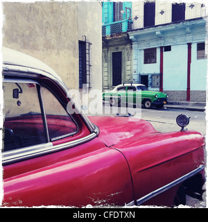 Street corner with red and green classic American cars, Havana Centro, Havana, Cuba, West Indies, Central America - Stock Photo
