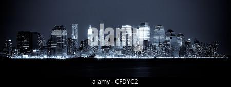 New York - Panoramic view of Manhattan Skyline by night - Stock Photo