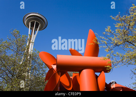 Olympic Iliad sculpture by Alexander Liberman and Space Needle, Seattle Center, Seattle, Washington State, USA - Stock Photo