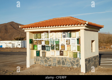 Mailboxes on bus shelter wall on Fuerteventura, Canary Islands, Spain - Stock Photo