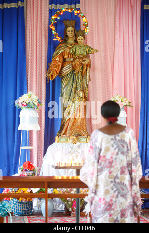 Prayer to Mary in an African church, Togo, West Africa, Africa - Stock Photo